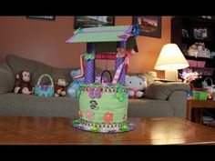 Here is another fun Diaper Cake Idea, a Wishing Well Diaper Cake! This is a fun Diaper cake to make. I hope you like it, Thank you so much : ) Items Needed t. Baby Shower Deco, Baby Shower Diapers, Baby Boy Shower, Baby Shower Gifts, Baby Gifts, Baby Showers, Diaper Cake Boy, Nappy Cakes, Couches