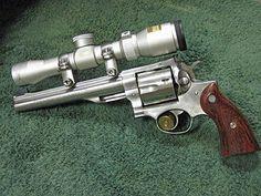 45mag colt | An older 1980s Ruger Redhawk Hunter in .44 Magnum with a custom scope.