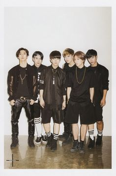B.A.P   Zelo is obviously so hunched over because we all know Jongup is NOT that close to his height!