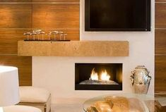 Read the suggestions from MCZ's architect on how to install a fireplace next to a TV set Installing A Fireplace, House, Tv, Tv Above Fireplace, Home, Fireplace, Tv Sets, Home Decor, Living Area
