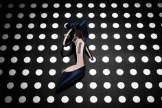 Navy blue satin bow heels by SJP Collection will make you feel like Cinderella at any occasion.