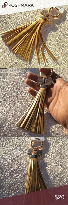 Tassel Keychain Bling Bow Very stunning key chain for your handbag. Gold for tassels and gold tone for hardware. Accessories Key & Card Holders