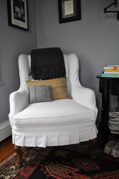 white slipcovered chair with pleats Pleated Slipcover, Cable Pillow and Linen Crewel