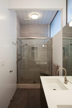 Countertop: Glacier White, Corian; tile: Cloud Vein Cut Deep Brushed Field Tile, Artistic Tile