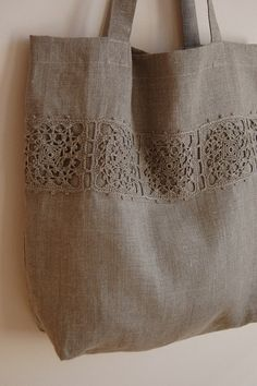 Natural linen tote/ shopping bag from quality medium weight European natural Eco linen fabric With beautiful hand crocheted natural linen lace on the This is gorgeous - matching the yarns in the crochet squares to the linen - brilliant This Pin was discov Crochet Gifts, Hand Crochet, Crochet Lace, Crochet Fabric, Crochet Flowers, Crochet Ideas, Lace Bag, Linen Shop, Burberry Handbags