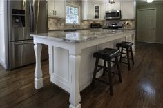 Custom-built island with legs, granite countertop