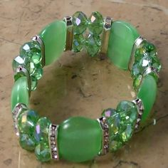 Party green sparkling bead stretch bracelet Pretty modern beads that are contemporary and looks good Elastic with bright green moonstone accents