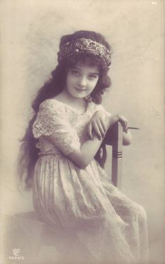 Edwardian girl with headband (real photo postcard)