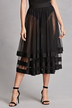 A sheer mesh midi skirt featuring layers with elasticized trim and an elasticized waist. This is an independent brand and not a Forever 21 branded item.
