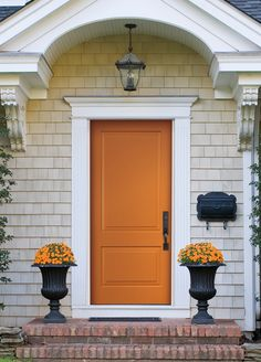 Make a bold first impression with an orange front door from Pella's Vibrancy Collection. This spirited color serves as a cheery backdrop for your favorite topiaries, flowers, and seasonal decor.