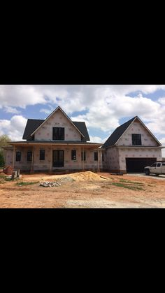 Farmhouse in texas by magnolia homes metal roof bricks for Gable garage plans