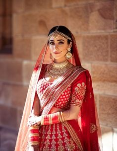 Looking for A bride dressed in a red Sabyasachi lehenga on her wedding day? Browse of latest bridal photos, lehenga & jewelry designs, decor ideas, etc. on WedMeGood Gallery. Indian Bridal Photos, Indian Bridal Outfits, Indian Bridal Fashion, Indian Bridal Wear, Bridal Dresses, Bridal Pictures, Designer Bridal Lehenga, Indian Bridal Lehenga, Red Lehenga