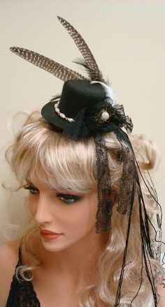 Headband; black top hat with feathers and lace