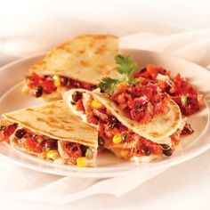 Fire-Roasted Tomato Quesadillas - Crisp quesadillas filled with fire-roasted tomatoes, corn, black beans and Chihuahua cheese, accented with fresh lime juice and cilantro.