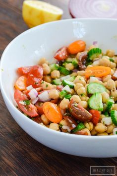 This Lemony Chickpea Salad features bright colors and equally bright flavors. A hearty recipe that is quick to assemble and loaded with healthy ingredients. This is a diary free recipe making it a perfect choice to bring to your next barbecue. - A Healthy Life For Me