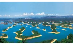 THOUSAND ISLAND LAKE IN CHINA   Photograph via Mind_Virus on Reddit   Qiandao Lake (Thousand Island Lake) is a man-made lake located in Chun'an County, Zhejiang, China. It was formed after the completion of the Xin'an River hydroelectric station. 1,078 large islands dot the lake and a few thousand smaller ones are scattered across
