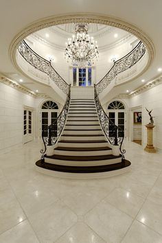 A staircase in your home can be a perfect interior symbol to bring a luxury design style. A big home with a big stair too usually is more recommended to have a luxury style on it. The staircase is als Mansion Interior, Dream House Interior, Luxury Homes Dream Houses, Dream Home Design, Modern House Design, Home Interior Design, Luxury Home Designs, Interior Architecture, Classical Architecture