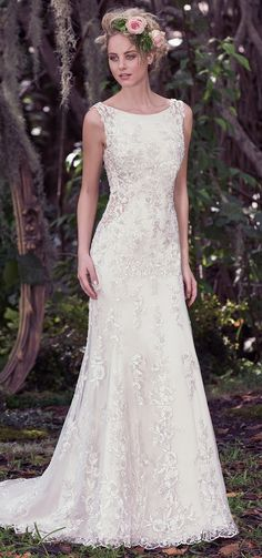 """""""Aspen"""" Wedding Dress by @maggiesottero. A classic A-line gown with a twist. This dress features illusion side panels and a daring open back with strap add a sexy touch. ___  #bridal #wedding #weddingdress #weddinggown #bridalgown #dreamgown #dreamdress #engaged #inspiration #bridalinspiration #bride #weddinginspiration #weddingdresses #romantic #lace #maggiesottero #maggiebride"""
