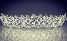 #product #2135  #Inspired by the #Great #Royal #Wedding, this lovely #tiara is reminiscent of #KateMiddleton #scalloped #headpiece of #glorious #diamonds! The #headpiece says it ALL, sampled with a 2 tier merrow edge veil.   #anjasdream  #holycommunions #littlebrides #elegance. #diamond #rhinestone #swarovski #details #littleprincess #flowergirl #love #specialoccasions #royalty #kids #kidscouture #crowns #veils #glorious #littlequeen