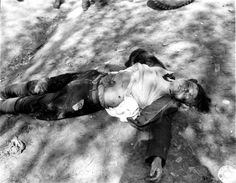 The body of an Ohrdruf concentration camp guard who was chased by former prisoners and dealt what he had coming. US troops did not intervene. April 10, 1945.