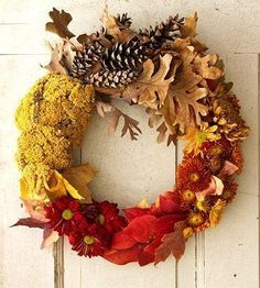 Celebrate fall colors - Create this beautiful fall wreath with a variety of materials that reflect autumn\'s hues: gold, red, orange and brown.