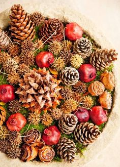 Layer pinecones, rose hips, dried pomegranates, sweetgum pods and moss for this easy look.    Tip Use materials from your garden first, then accent with others shown here