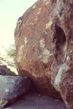 Climbing in East Mountain in Hueco Tanks.