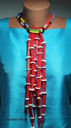 Marlene Brady. Felted ropes, bead crochet and polymer clay.