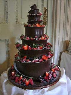 Extreme red and black wedding cake: with strawberries and dark chocolate.