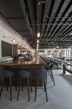 Berg'n Restaurant by Selldorf Architects in Brooklyn, New York.  / Garage Conversion