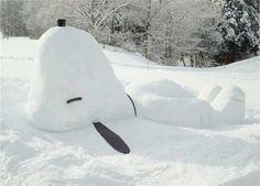 Snoopy making snow angels - #street art  #snow art