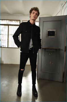 Felix Gesnouin rocks all black in skinny jeans, ripped at the knees with a striped cotton t-shirt from Mango Man.