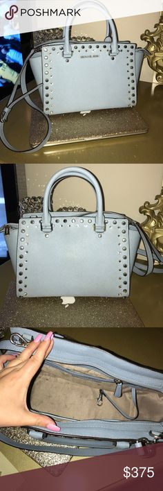 Michael Kors Selma Jewel Satchel Light Blue Michael Kors Selma Jewel Satchel Light Blue Limited Edition!!!! Inside slightly used. In great condition!!! Looks great with jeans, whites and black clothes! Zipper still works great! Michael Kors Bags Satchels