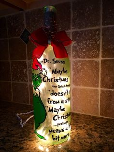 The Grinch wine bottle light. Can customize any design. Please see my facebook page Berks Winedesign for more ideas and products. thank you.