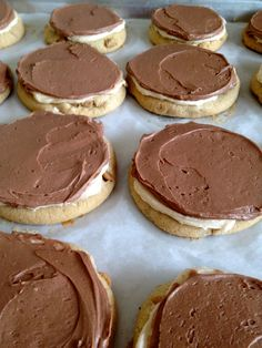 Frosted Peanut Butter Cookies! A layer of peanut butter frosting AND buttercream frosting!  These look divine!!