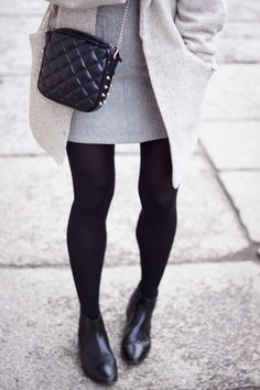 place the purse (focus on how she wears the chelsea boots with black tights)