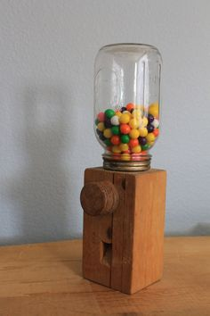 Creative use of glass ball jar and block of wood... Great for kids
