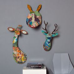 I like this (can't believe I'm liking any part of the faux animal head craze!), but it looks like decoupage...what if it was actual stuffed animal heads done in crazy quilt fabric?
