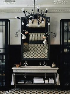 Bathroom - Large porcelain sink for double duty, 'octopus' like light fixtures, industrial chic elements.: