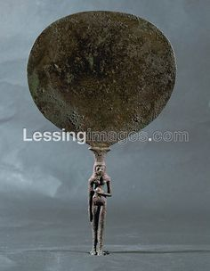 Mirror with handle in the shape of a woman from Gaza. Egyptian-Canaanite