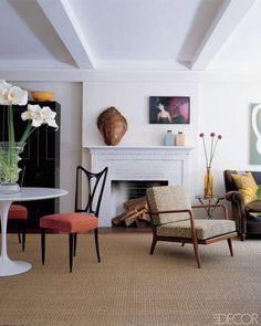 TRY: A spare mantel design with off-center art like PETER SOM, whose home was featured in ELLE DECOR in September 2005.