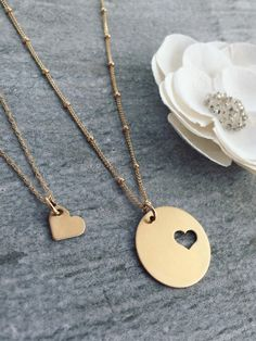 gold circle and heart necklaces