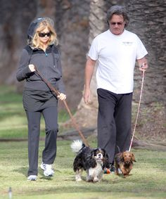 Couple Goldie Hawn and Kurt Russell sharing a kiss while walking their dogs in Pacific Palisades, California on March 28, 2012.