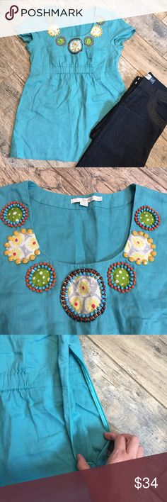 Boden Turquoise Linen Scoopneck Beaded Tunic Top Summertime is here! This thing is chic and fun and breathable to keep you cool no matter how high the mercury rises! Cute funky style with amazing Boden quality. UK size 14, US size 10. EUC, side invisible zip closure. Approx measurements when laid flat = 18 inches armpit to armpit, 30 in drop from shoulder to bottom hem. Jeans in first picture also available in separate listing - create a bundle and save! Boden Tops