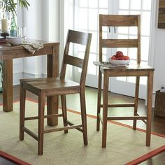 $199, bit pricey. Do I like this look? Pier 1, The classic schoolhouse chair grows up—literally. Solid hardwood frame features a contoured seat and adult-height ladderback with two wide rails for lumbar support. Sturdy box stretcher provides grown-up stability, too.