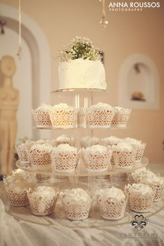 cupcakes and cake. If you want to go with the cupcakes idea, we could do something like this and then have a couple of cake stands either side with the remainder of the cupcakes.