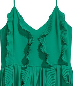 Green. Calf-length dress in crêped chiffon. V-neck, narrow, adjustable shoulder straps, and pleated ruffles. Seam at waist, concealed zip at back, and