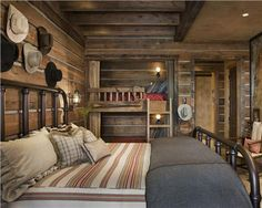 Rustic Western Bedroom With Cowboy Hats Above The Headboard By Jerry Locati Stylish