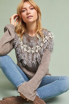 This Anthropologie Fringed Isle Pullover sweater is gorgeous! Click photo to shop!  #sweaters #fallstyle #affiliatelink