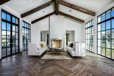 Contemporary Living Room with Charlestown Oak - Mocha, herringbone tile floors, stone fireplace, Hope's Steel Windows & Doors